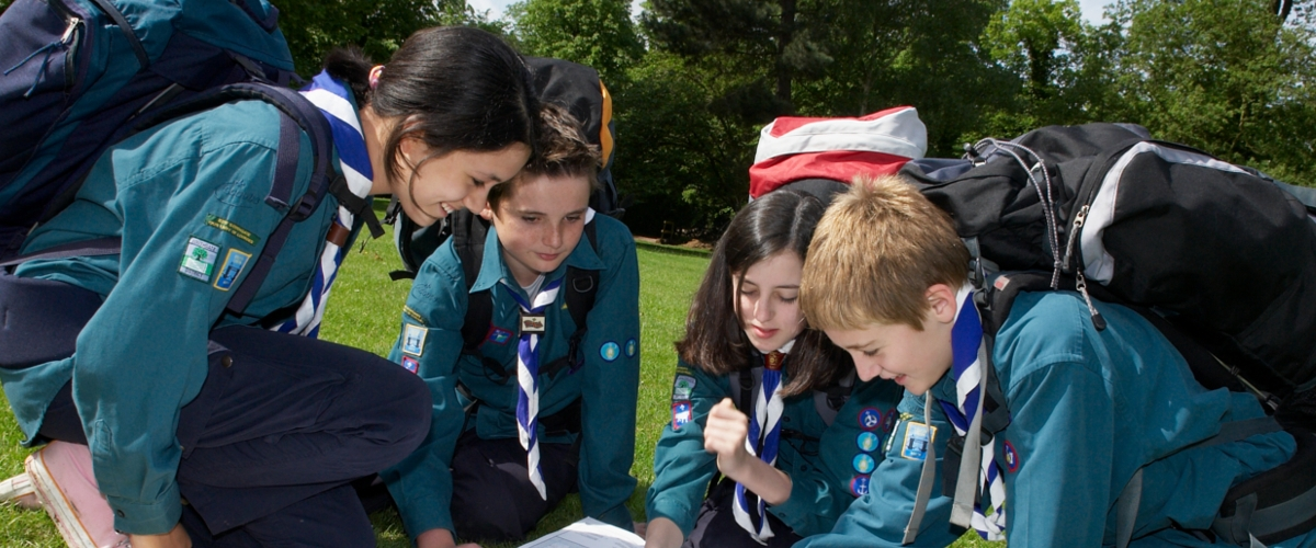 5th Douglas Scouts Around a map